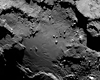 Smooth_region_on_the_base_of_the_body_section_by_osiris_narrow_angle_camera_received_6_augustus_with_boulders_craters_and_cliffs